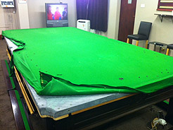 Example of cloth replacement on snooker table showing exposed slate bed